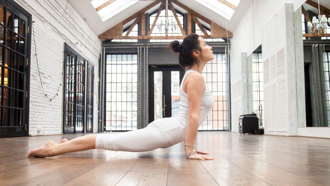 Upward facing dog yoga pose in home studio